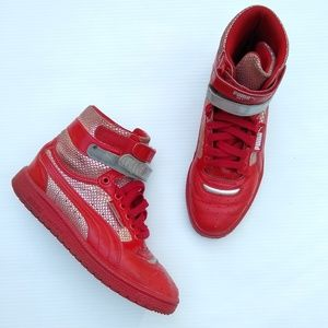 Puma • contact red retro high top sneakers